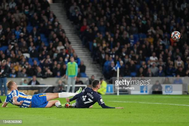 Phil Foden of Manchester City scores their team's second goal during the Premier League match between Brighton & Hove Albion and Manchester City at...