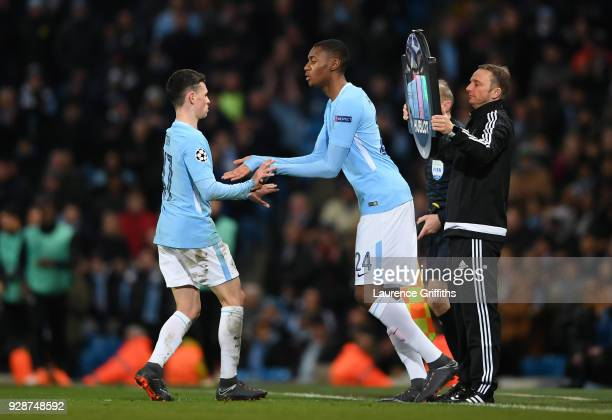 Phil Foden of Manchester City shakes hands with Tosin Adarabioyo of Manchester City during the UEFA Champions League Round of 16 Second Leg match...