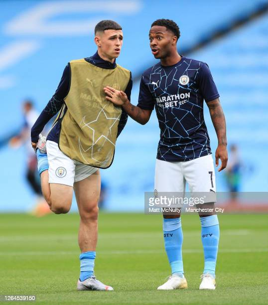 Phil Foden of Manchester City speaks with Raheem Sterling of Manchester City during the warm up prior to the UEFA Champions League round of 16 second...