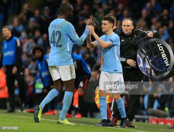 Phil Foden of Manchester City substitutes with Yaya Toure during the UEFA Champions League Group F soccer match between Manchester City FC and...