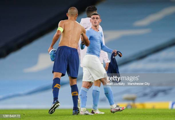 Phil Foden of Manchester City swaps shirts at full time with Pepe of Porto during the UEFA Champions League Group C stage match between Manchester...