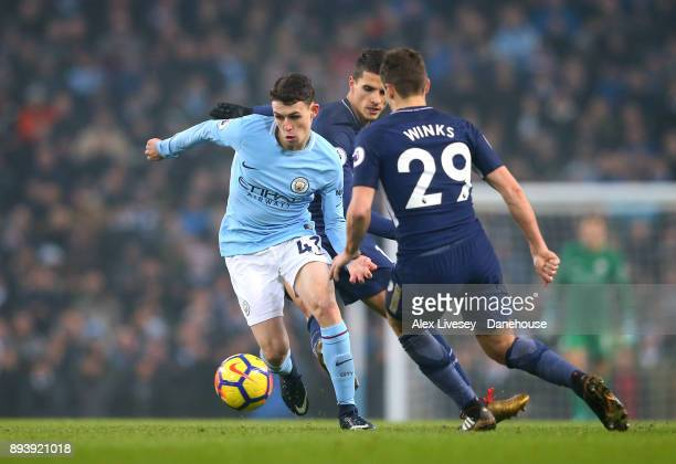Phil Foden of Manchester City takes on Harry Winks of Tottenham Hotspur during the Premier League match between Manchester City and Tottenham Hotspur...
