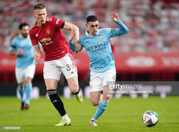 Phil Foden of Manchester City takes on Scott McTominay of Manchester United during the Carabao Cup Semi Final match between Manchester United and...