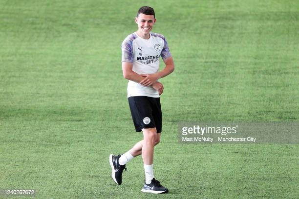 Phil Foden of Manchester City warms up during the training session at Manchester City Football Academy on June 01 2020 in Manchester England