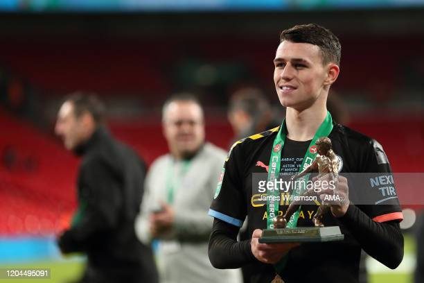 Phil Foden of Manchester City with the man of the match trophy during the Carabao Cup Final between Aston Villa and Manchester City at Wembley...