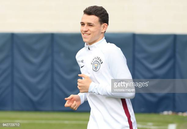 Phil Foden reacts as he walks to training at Manchester City Football Academy on April 6 2018 in Manchester England