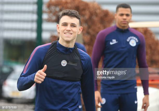 Phil Foden reacts to the camera as he walsk to training at Manchester City Football Academy on February 8 2018 in Manchester England