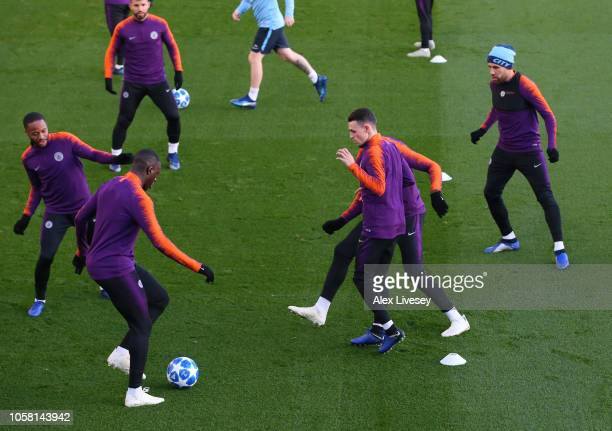 Phil Foden takes part in a drill with team mates during a Manchester City training session at Manchester City Football Academy on November 6 2018 in...