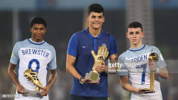 Phil Foden with his 'Man of the Tournament' trophy Rhin Brewster with his 'Highest Scorer' trophy of England and goalkeeper Gabriel Brazao with his...