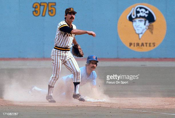 Phil Garner of the Pittsburgh Pirates gets the put out at second base on Bill Buckner of the Chicago Cubs during an Major League Baseball game circa...