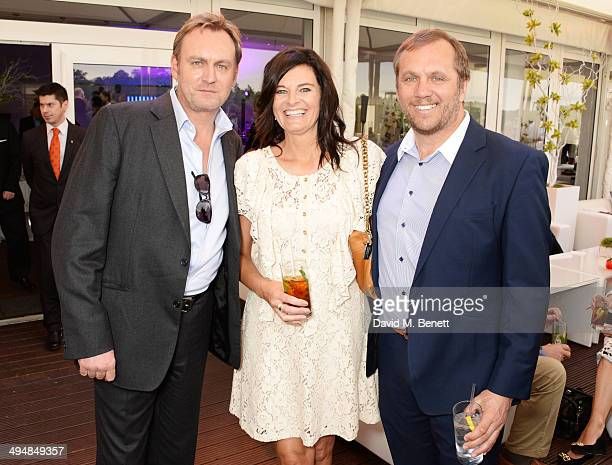 Phil Glenister Helen BowenGreen and Dean Andrews attend day one of the Audi Polo Challenge at Coworth Park Polo Club on May 31 2014 in Ascot England