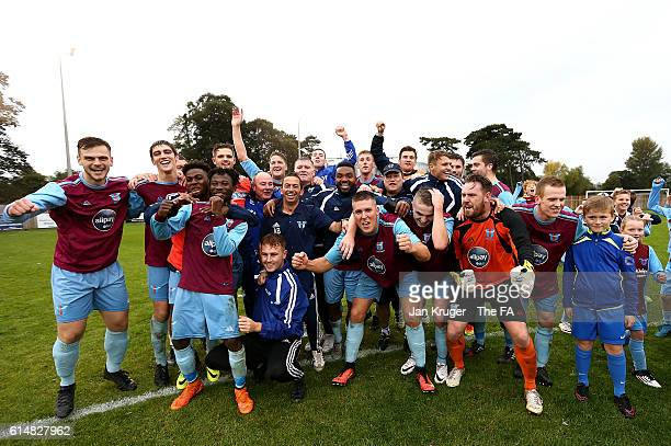 Phil Glover, captain of Westfield celebrates victory with his team during the Emirates FA Cup 4th round qualifying match between Westfields and...