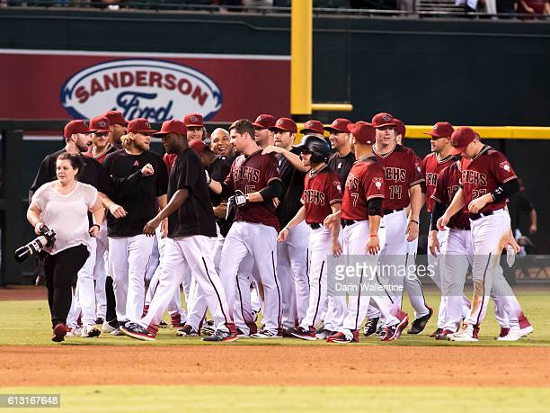 Phil Gosselin of the Arizona Diamondbacks celebrates with his teammates after a walkoff single in the ninth inning of the MLB game against the San...