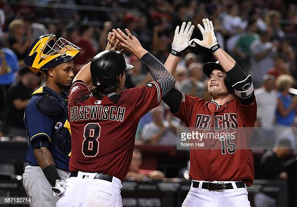 Phil Gosselin of the Arizona Diamondbacks celebrates with teammate Tuffy Gosewisch after hitting a home run off of Michael Blazek of the Milwaukee...