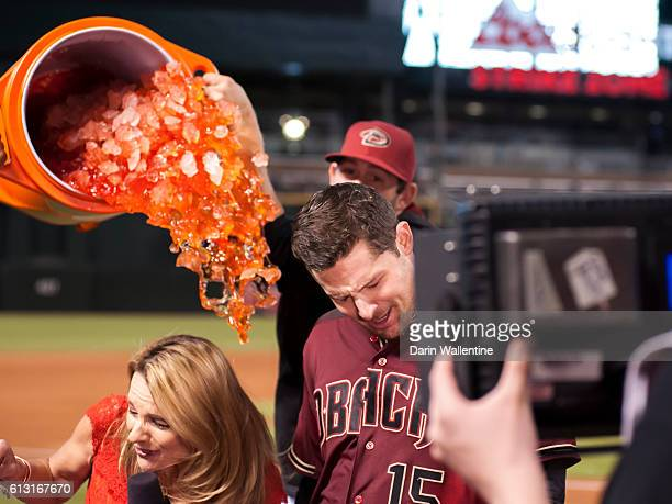 Phil Gosselin of the Arizona Diamondbacks is showered with gatorade by his teammates during an interview after a walkoff single in the ninth inning...