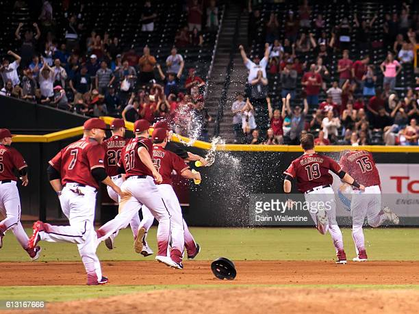 Phil Gosselin of the Arizona Diamondbacks is showered with water by his teammates after a walkoff single in the ninth inning of the MLB game against...