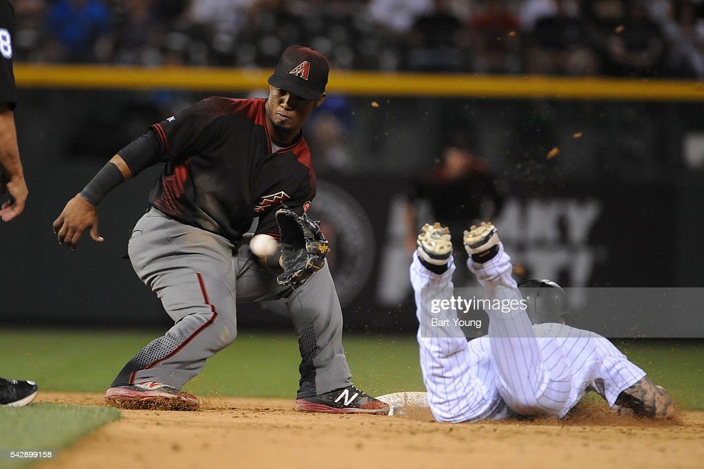 Phil Gosselin #15 of the Arizona Diamondbacks makes a play at second base in the 5th inning against the Colorado Rockies at Coors Field on June 24, 2016 in Denver, Colorado. The Diamondbacks defeat the Rockies 10-9.