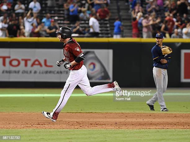 Phil Gosselin of the Arizona Diamondbacks rounds the bases after hitting a home run off of Michael Blazek of the Milwaukee Brewers during the fifth...