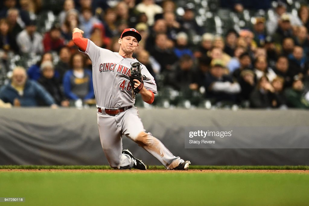 Phil Gosselin #46 of the Cincinnati Reds makes a throw to first base during the eighth inning of a game against the Milwaukee Brewers at Miller Park on April 16, 2018 in Milwaukee, Wisconsin.