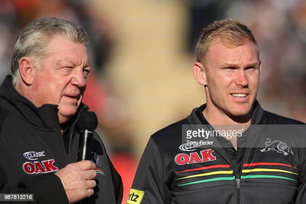 Phil Gould talks with Peter Wallace during the round 16 NRL match between the Penrith Panthers and the Manly Sea Eagles at Panthers Stadium on June...