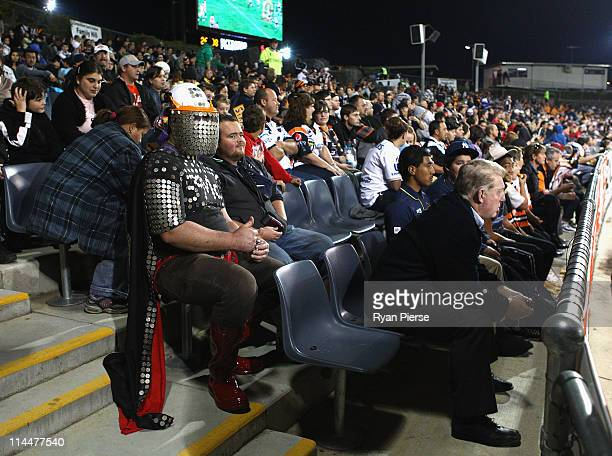 Phil Gould, the new director of coaching of the Panthers, looks on from the crowd during the round 11 NRL match between the Wests Tigers and the...