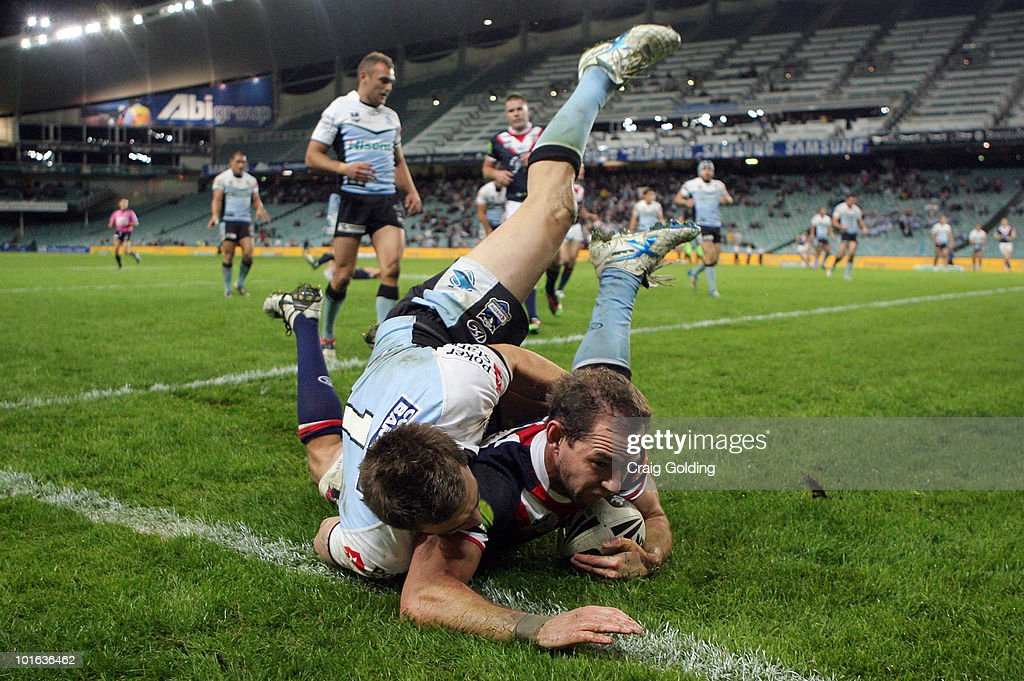Phil Graham of the Roosters scores a try during the round 13 NRL match between the Sydney Roosters and the Cronulla Sharks at Sydney Football Stadium on June 5, 2010 in Sydney, Australia.