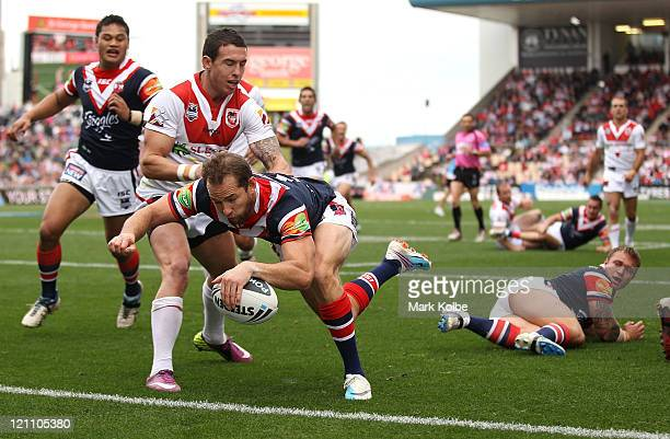 Phil Graham of the Roosters scores a try during the round 23 NRL match between the St George Illawarra Dragons and the Sydney Roosters at WIN Stadium...
