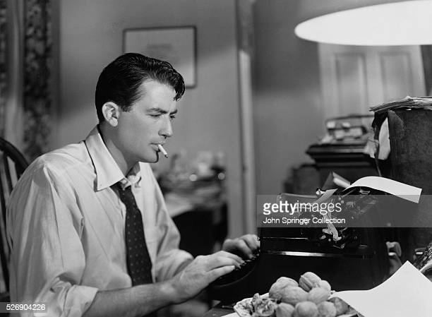 Phil Green busy at the typewriter on a series of magazine articles dealing with intolerance in a scene from Gentlemen's Agreement