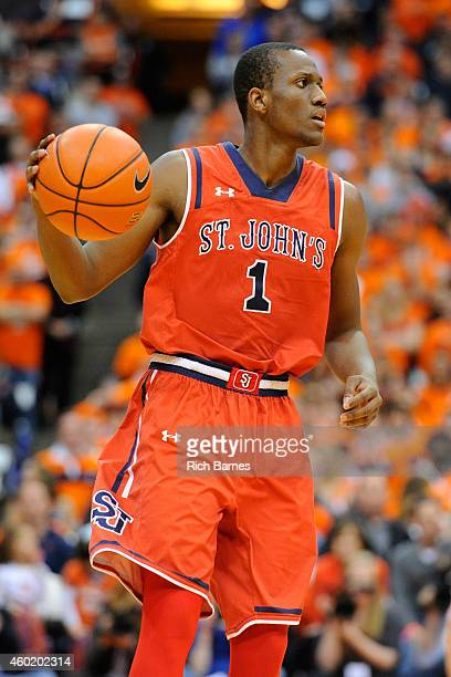 Phil Greene IV of the St John's Red Storm controls the ball against the Syracuse Orange during the second half at the Carrier Dome on December 6 2014...