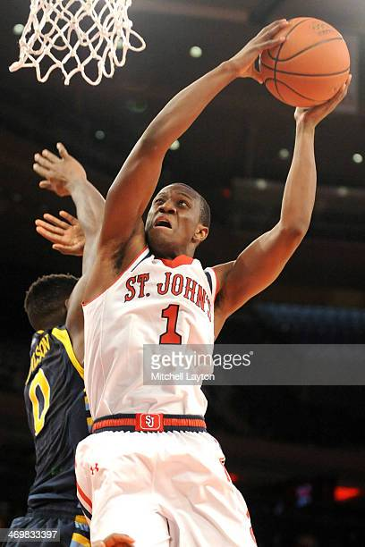 Phil Greene IV of the St John's Red Storm drives to the basket during a college basketball game against the Marquette Golden Eagles on February 1...