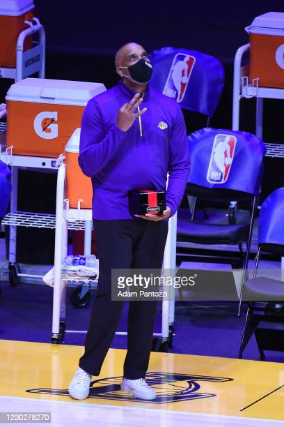 Phil Handy of the Los Angeles Lakers reacts as he gets his 2019-20 NBA Championship ring during the ring ceremony before the game against the LA...