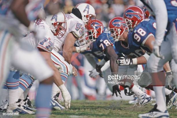 Phil Hansen Defensive End for the Buffalo Bills prepares to rush blockMark Stepnoski Center Guard for the Tennessee Oilers at the snap during their...