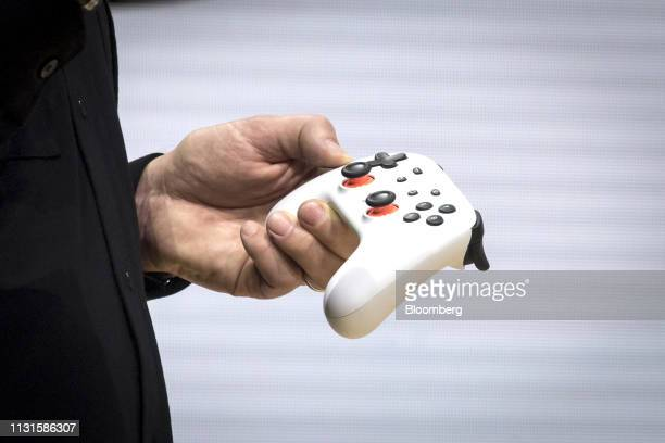 Phil Harrison vice president of Google LLC holds the new Google gaming controller during an event at the Game Developers Conference in San Francisco...