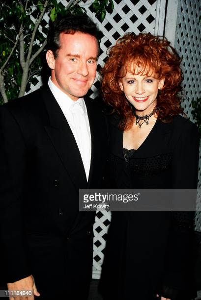 Phil Hartman and Reba McEntire during Fox Billboard Awards 1994Backstage at Universal Amphitheater in Universal City California United States