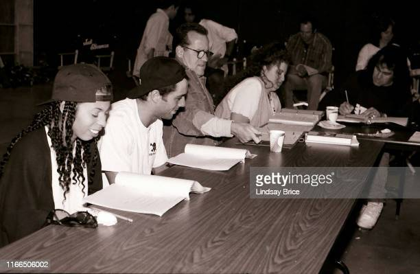 Phil Hartman elicits smiles from castmates Khandi Alexander and Joe Rogan during table read for NewsRadio at Sunset Gower Studios on August 10 1995...