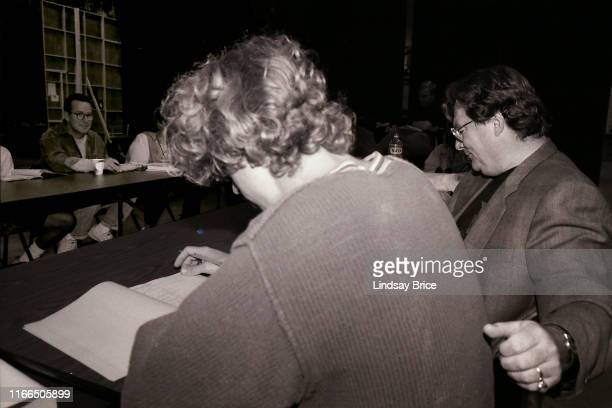 Phil Hartman smiles from across the table as Andy Dick reads his lines Stephen Root's arm resting upon the back of Andy's chair during table read for...