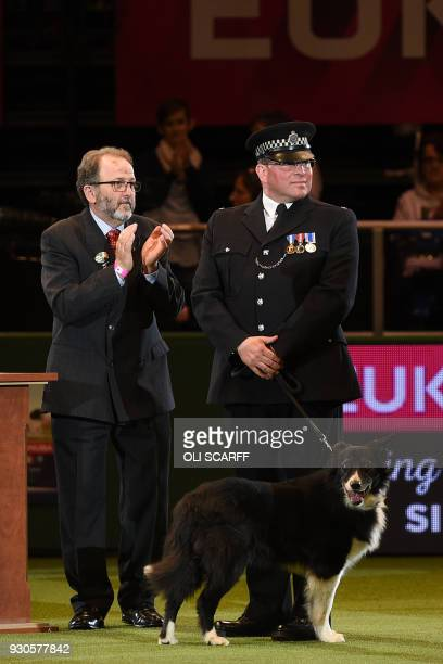 PC Phil Healey and his dog 'Mojo' receive the Humanitarian Award on the final day of the Crufts dog show at the National Exhibition Centre in...
