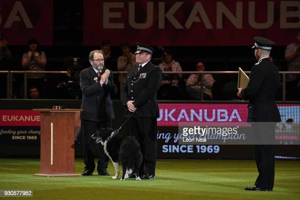 Phil Healy and his police dog eightyearold collie Mojo receive a special award for their work searching for explosives in the aftermath of the...