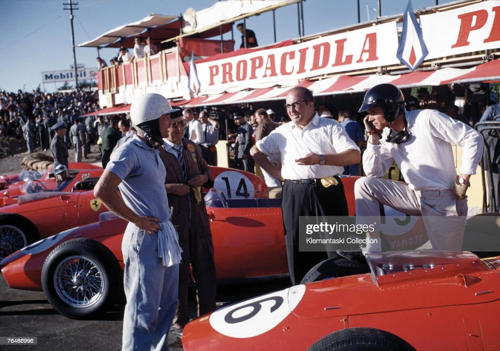 Phil Hill, Luigi Bazzi, Carlo Chiti and Dan Gurney with the Ferraris in the pits during the Portuguese Grand Prix at Monsanto, 23rd August 1959.