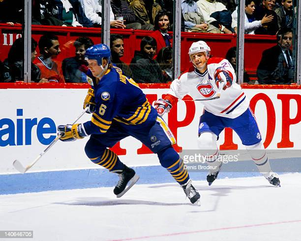 Phil Housley of the Buffalo Sabres skates for the puck during a game against the Montreal Canadiens Circa 1980 at the Montreal Forum in Montreal...