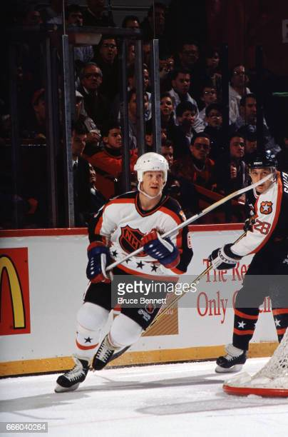 Phil Housley of the Campbell Conference and the Winnipeg Jets skates on the ice during the 1991 42nd NHL AllStar Game against the Wales Conference on...