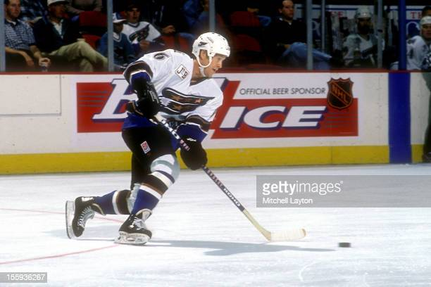 Phil Housley of the Washington Capitals skates during a hockey game against the Los Angeles Kings on October 12 1996 at USAir Arena in Landover...
