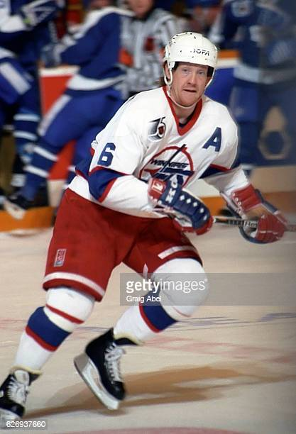Phil Housley of the Winnipeg Jets turns up ice against the Toronto Maple Leafs during game action on February 15 1992 at Maple Leaf Gardens in...