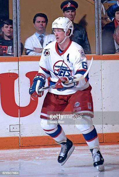 Phil Housley of the Winnipeg Jets watches the play develop against the Toronto Maple Leafs during game action on February 15 1992 at Maple Leaf...
