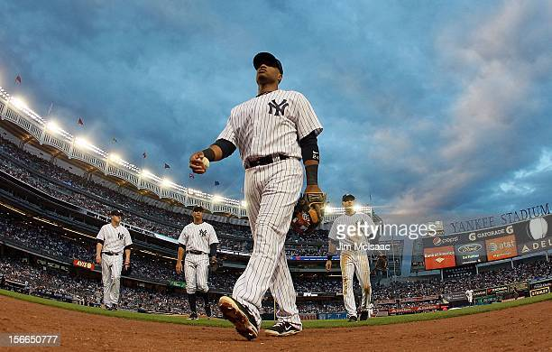 Phil Hughes Alex Rodriguez Robinson Cano and Derek Jeter of the New York Yankees walk to the dugout after an inning against the Cleveland Indians at...