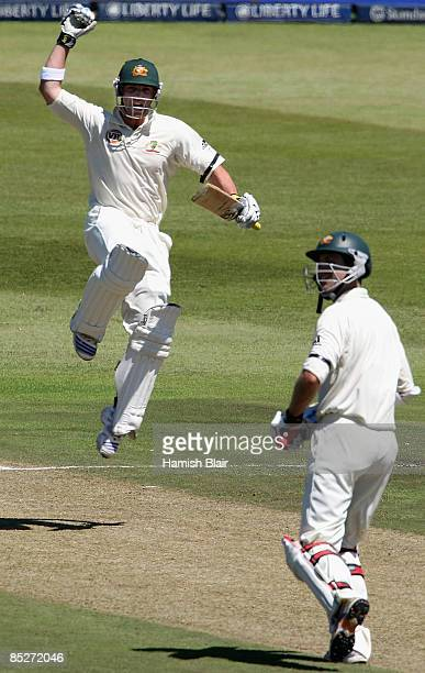 Phil Hughes of Australia celebrates his century with team mate Simon Katich looking on during day one of the Second Test between South Africa and...