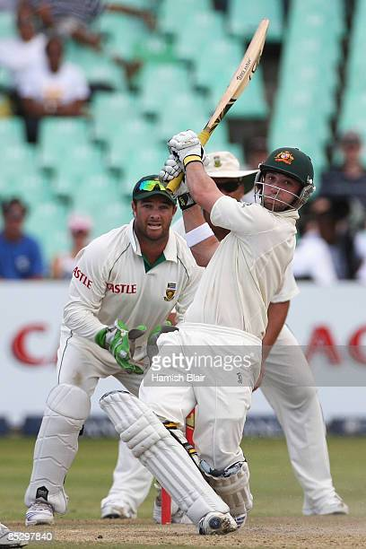 Phil Hughes of Australia hits a six with Mark Boucher and Jacques Kallis of South Africa looking on during day three of the Second Test between South...