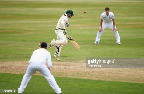 Phil Hughes of Australia is stuck by a bouncer during day two of the Tour Match between England Lions and Australia at The County Ground on August 17...