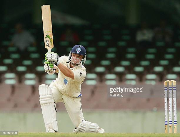 Phil Hughes of the Blues hits a cover drive for four during day one of the Pura Cup match between the New South Wales Blues and the South Australian...