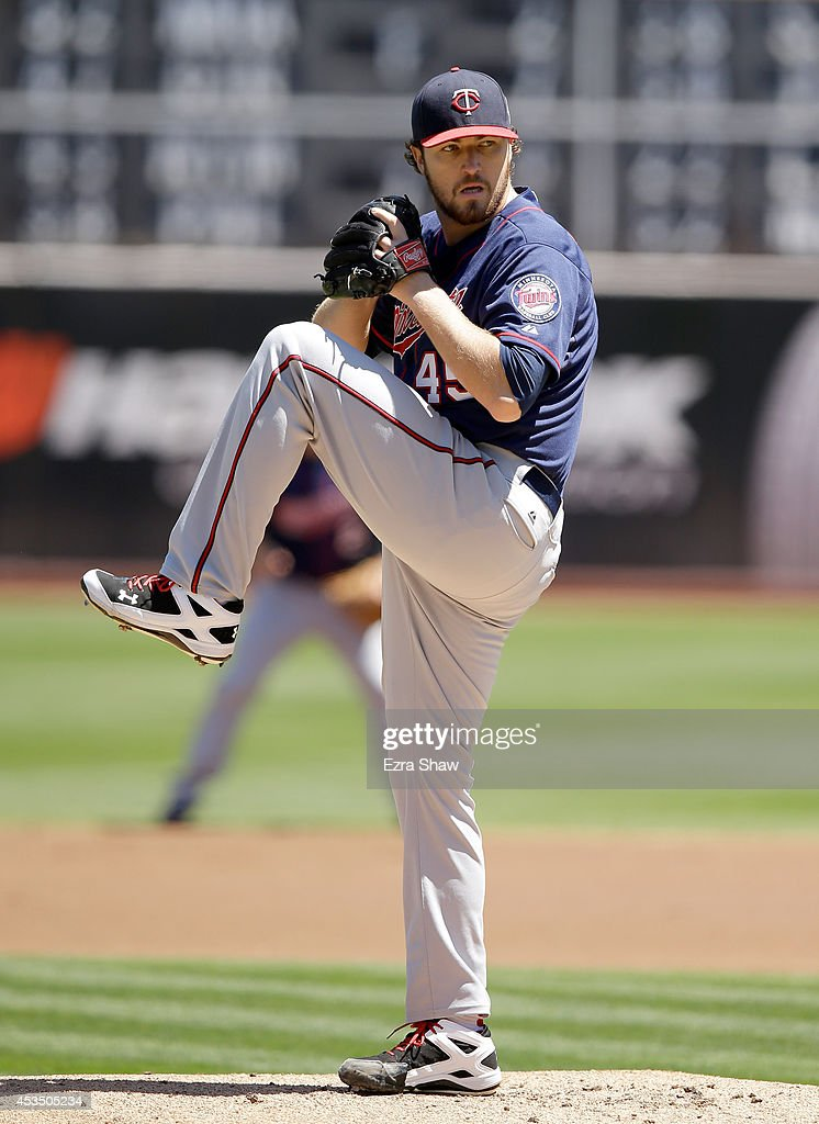 Phil Hughes #45 of the Minnesota Twins pitches against the Oakland Athletics at O.co Coliseum on August 10, 2014 in Oakland, California.